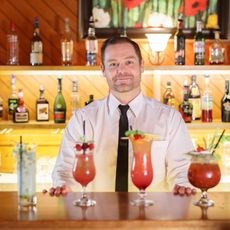 bartender with 4 cocktails